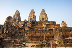 Phnom Bakheng temple at sunset. Phnom Bakheng at Angkor, Cambodia, is a Hindu and Buddhist temple in the form of a temple mountain, dedicated to Shiva Stock Image
