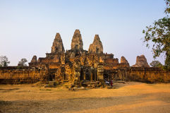 Phnom Bakheng temple at sunset. ANGKOR WAT, CAMBODIA - JANUARY 28, 2015: Phnom Bakheng at Angkor, Cambodia, is a Hindu and Buddhist temple in the form of a Stock Photography