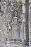 在寺庙Phnom Bakheng墙壁上的Apsara  库存图片