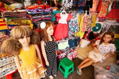 Khmer teen working in children clothing shop on the footpath, ch royalty free stock image