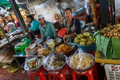 Food vendors in an open air market in Cambodia Royalty Free Stock Image
