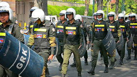 PHNOM PENH, CAMBODIA: Cambodian riot police march on a central street stock video