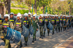 PHNOM PENH, CAMBODIA - 29 DEC 2013: Cambodian riot police march Royalty Free Stock Photography