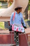 Disabled man sell souvenirs at Wat Phnom, he doesn't beg, he want to work stock images