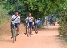 The Cambodian children. PHNOM PENH, CAMBODIA - JANUARY 05 2015: Cambodian children are students going to classes at the school on bicycles Stock Photography
