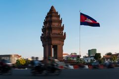 Phnom Penh, Cambodia. Traffic rush around the Independence monument, with its Khmer architecture style, in Phnom Penh, Cambodia capital city. Blurred motion Stock Photography