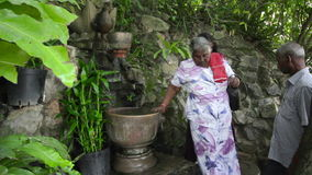 PHNOM PENH - JUNE 2012: indians wash hair with holy water stock video