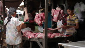 PHNOM PENH - JUNE 2012: local asian market butchers Royalty Free Stock Images