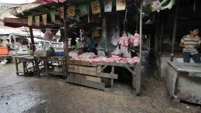 PHNOM PENH - JUNE 2012: local asian market butchers Royalty Free Stock Photo