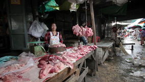 PHNOM PENH - JUNE 2012: local asian market butchers Royalty Free Stock Photo