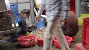 PHNOM PENH - JUNE 2012: local asian market butchers Stock Photography