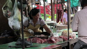 PHNOM PENH - JUNE 2012: local asian market butchers stock footage
