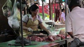 PHNOM PENH - JUNE 2012: local asian market butchers Royalty Free Stock Photography
