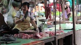 PHNOM PENH - JUNE 2012: local asian market butchers Royalty Free Stock Image
