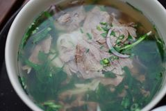 Bowl of beef pho close up look. Vietnamese traditional rice noodle soup with beef. Stock Photography