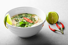 Pho bo soup with lime and chili Stock Photos