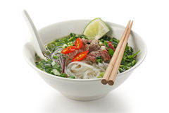 Pho bo , Vietnamese rice noodle soup with sliced r