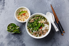 Pho Bo vietnamese Soup. With beef on concrete background royalty free stock images