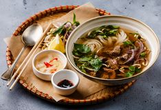 Pho Bo vietnamese Soup with beef in tray Royalty Free Stock Image