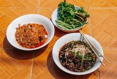Pho Laos and Khao Soi Laos noodle soup, Luang Prabang food. Pho Laos black herbal soup noodle and Khao Soi Laos spicy noodle soup, Luang Prabang local street royalty free stock photos