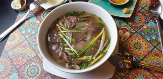 Pho soup with beef and noodle at thai restaurant in timisoara Romania. Pho soup beef noodle thai restaurant timisoara romania stock photos