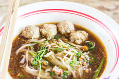 Pho Tai style noodle soup with vegetables on table Stock Photography