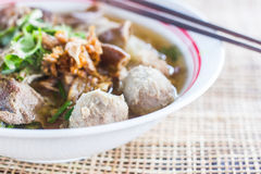 Pho Tai style noodle soup with vegetables on table Royalty Free Stock Image