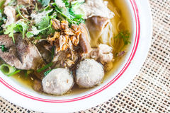 Pho Tai style noodle soup with vegetables on table Stock Images