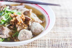 Pho Tai style noodle soup with vegetables on table Royalty Free Stock Photography