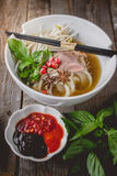 Pho Vietnamse Noodle Soup on Old Wood. Image for Food Advertise. Concept Stock Photos
