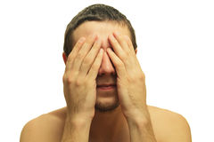 Phobia. Man closes his eyes with his hands Royalty Free Stock Image