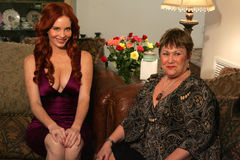 Phoebe Price. And Sharon Tirabasso on the set of a television commercial for 'Lotion Glow'. Private Location, Los Angeles, CA. 11-09-06 Stock Photography
