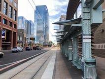 Metro Rail Train Station, Phoenix, AZ. PHOENIX, AZ - DECEMBER 11, 2017: Metro rail train traffic light sign with announcement in Spanish at 3rd St and Washington stock photography
