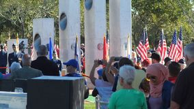Phoenix, AZ/USA – 11/11/2017:Veterans Day Ceremony Crowd and Memorial Close Up stock footage