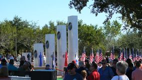 Phoenix, AZ/USA – 11/11/2017:Veterans Day Ceremony Crowd and Memorial Full stock footage