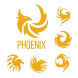 Phoenix fantasy bird and flame wings vector icons. Phoenix fantasy bird logo templates. Vector icons of golden mystic firebird in flame fire wings for airlines Royalty Free Stock Photography