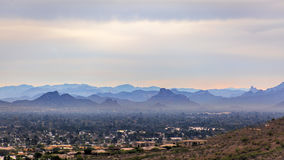 Phoenix hazy mountains littering the background. Cityscape view from up high Stock Images