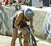 Phoenix Ironman Triathlon. Competitor Maggs Morris has trouble in the cycling stage of the April 2008 Ironman Triathlon in Tempe Arizona Stock Photography