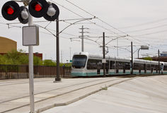 Phoenix Metro Light Rail Train. Light rail train of the Phoenix Metro system photographed in Tempe Arizona at a rail road crossing stock image