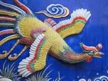 Phoenix op muur royalty-vrije stock afbeeldingen