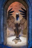 Phoenix statue at the entrance to Hogwarts Headmaster`s office. LEAVESDEN, UK - FEBRUARY 24TH 2018: Phoenix statue at the entrance to Hogwarts Headmaster`s Royalty Free Stock Image
