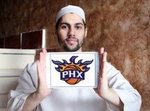 Phoenix Suns American basketball team logo. Logo of Phoenix Suns team on samsung tablet holded by arab muslim man. The Phoenix Suns are an American professional Stock Photography