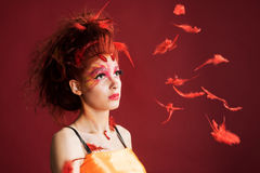 Phoenix woman. Young girl portrait and flying feathers stock photography