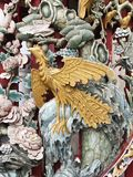Phoenix wood carving in Chinese temple. Gold phoenix wood carving in Chinese temple stock images