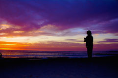 Phogographer de la puesta del sol Imagen de archivo libre de regalías
