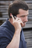 On the phone. Close up of a man with a mobile phone royalty free stock images