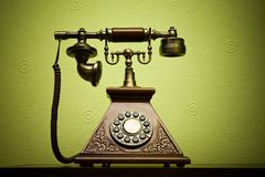 Phone. The old phone with disc dials on the background wallpaper Stock Photo