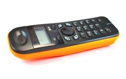 Phone. Orange radio phone, with a black dial stock photo