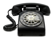 Phone. An old black rotary phone on white with clipping path Stock Photo