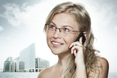 Phone. High key portrait of young woman with mobile phone Royalty Free Stock Photography